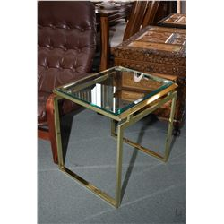 Three brass and bevelled glass side tables including two matching and one complimenting