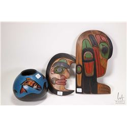 "Selection of Haida carvings including two artist signed Noel Ashley wall plaques, ""Haven"" and ""Moon"""