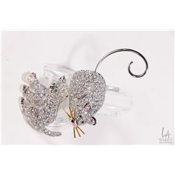 "Two Swarovski crystal brooches including kitten playing with pearl and ""Squeak"" the mouse"
