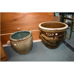 "Two non-matching planters including Oriental motif 16"" and a floral planter 12"". Note: No Shipping."