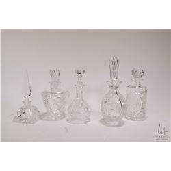 Five lead crystal perfume bottles with stoppers . Note: No Shipping. Local Pickup Only