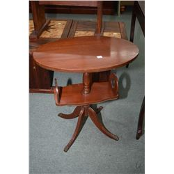 Center pedestal Regency style occasional table with book storage