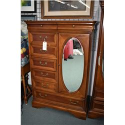 Quality modern eight drawer, single door chiffarobe with oval bevelled mirror made by Lexington, 58""