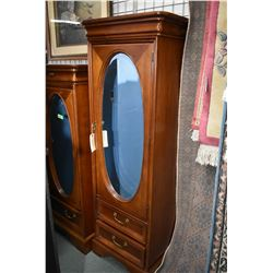 "Two drawer single door chiffarobe made by Lexington with oval bevelled mirror, 68"" in height, matche"