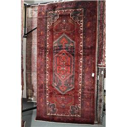 100% Iranian Zanjan wool area carpet with center medallion, red background and highlights of soft pu