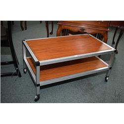 """Quality aluminium framed and teak two tiered occasional table on castors, approximately 30"""" X 18"""""""