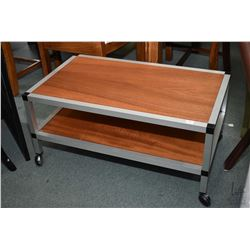 "Quality aluminium framed and teak two tiered occasional table on castors, approximately 30"" X 18"""