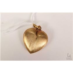 18kt yellow gold heart shaped pendant. Retail replacement value $ 950.00