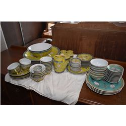 """Large selection of Chinese famille jaune dinnerware including four 14 1/2"""" round platters, oval plat"""