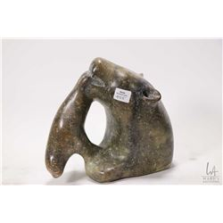 """Soapstone carved bear eating a seal, signed by artist Dave Iniq (?) 8"""" in height"""