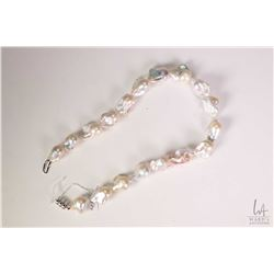 "Unusual freshwater culture baroque pearl necklace 18.5"" in length with 14kt white gold clasp. Retail"