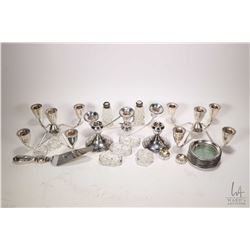 Selection of sterling silver collectibles including a pair of matched five branch candle holder sans