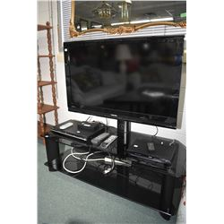 Toshiba model 40RV525R flat screen television mounted to smoked glass table/ stand plus a Toshiba SD