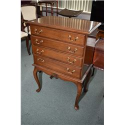 Interesting semi contemporary mahogany chest on tall cabriole supports with four shallow drawers