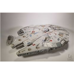 "Millenium Falcon battery toy circa 2008, 32"" in length, includes a Hans Solo figure and a Republic b"
