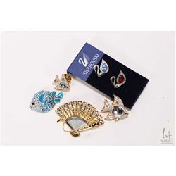 Selection of Swarovski crystal brooches and pins including gold tone fishes and fan, silver toned fi