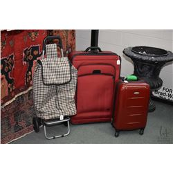 Selection of luggage including hard Samsonite case, soft rolling suitcase and a cart with wheels. No