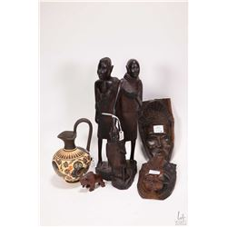 """Selection of wooden carvings including three African figures; father, mother and child 12"""" in height"""