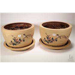 """Matched pair of handpainted clay planters with under trays, both 12 1/2"""" in diameter"""