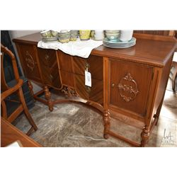 Matched grain walnut, two door, two drawer sideboard to match lot 549