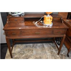Small semi contemporary match grain five drawer desk. Note center drawer has dropped front for keybo