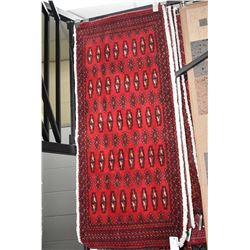 """100% Iranian wool scatter rug with red background and fringed sides, 22"""" X 53"""""""
