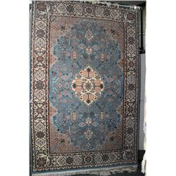 Large wool blend area carpet with center medallion, floral and foliage design in shades of blue, tau