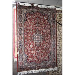 Fine wool blend area carpet with center medallion, overall floral design in shades or red, green, cr