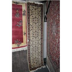 Wool blend carpet runner with floral design, taupe background and highlights of blue, green, cream e