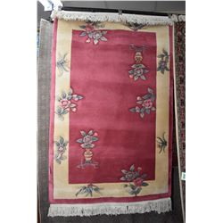 """Sculpted wool area carpet with deep dusty pink center and taupe banding and flowers. 48"""" X 72"""""""
