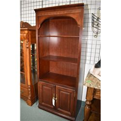 """Illuminated wall unit with glass top shelf and cupboard storage, 77"""" in height"""