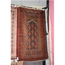 """Wool area carpet in tones of taupe, orange, red etc. 36"""" X 62"""""""