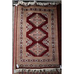 Wool silk blend area carpet with triple medallion and multiple borders, brick red background and hig