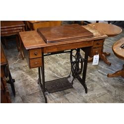 Singer treadle sewing machine in walnut cabinet note with some missing veneer