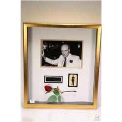 Gilt framed black and white photograph of Prime Minister Pierre Elliot Trudeau with rose and pin, pe