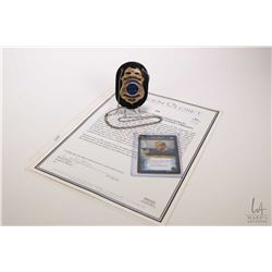 Authentic television prop from the series 24 Counter Terrorist Unit (CTU) badge worn by Kiefer Suthe