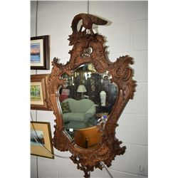 "Antique European hand carved bevelled wall mirror with bird motif finial, overall height 46"". Note:"