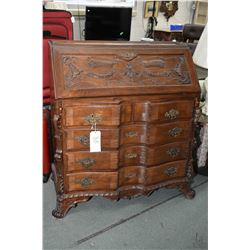 Antique five drawer drop front bureau with original cast pulls, fitted interior including several di