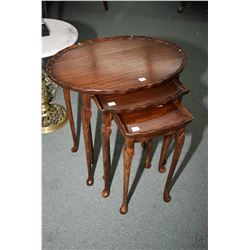 Set of three mahogany nesting tables on tall cabriole supports