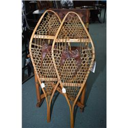 "Pair of vintage snow shoes with leather bindings, manufactured by BASTIEN Manufacturer, 43"" in lengt"