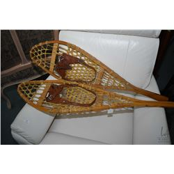 "Pair of vintage snow shoes with leather bindings, 38"" in length"