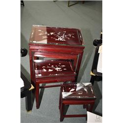 Four piece set of Oriental nesting tables with inlaid mother-of-pearl panels and glass top protector