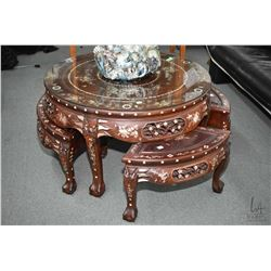 "Rosewood heavily mother-of-pearl 36"" round table with four nesting stools, hand carved detail and ba"