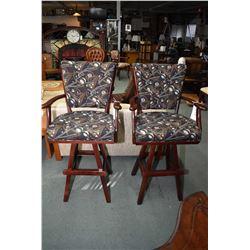 Two billiard motif open arm swivelling bar stools
