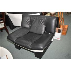 Ultra modern Italian made leather loveseat and matching chair made by Italcomfort, note matches lot