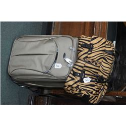 Tumi brand small roller case and Tumi brand tiger print soft carry-all