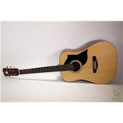 "Conservatory acoustic guitar model no. C305, label inside ""C.F. Martin Organization in Canada"" appea"