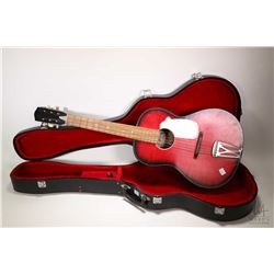 Raven red and black guitar in fitted hard case, note heel possibly reglued