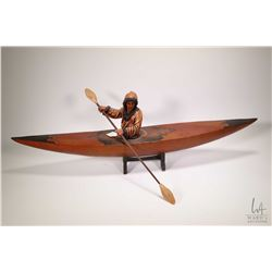 "Composite figure of a kayaker 35"" in length"
