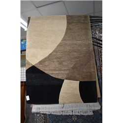 """Handcrafted Indian made area carpet in modern geometric design and tones of browns and black 96"""" X 1"""